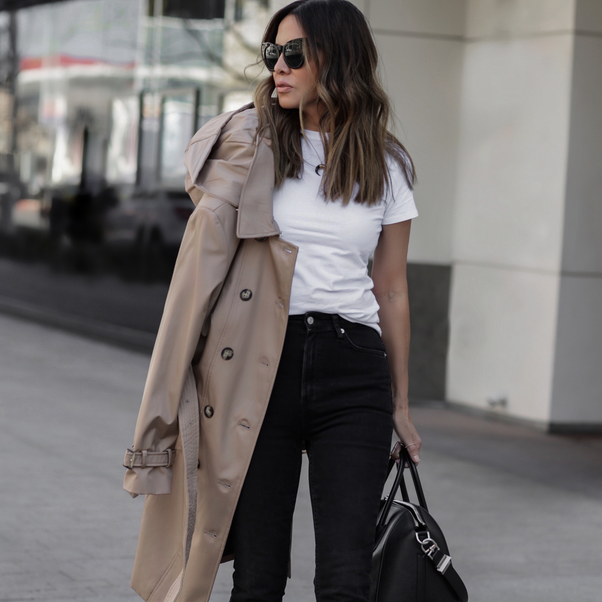 spring fashion trends 2019, spring fashion trends on a budget, lolario style blogger in black jeans and trench coat