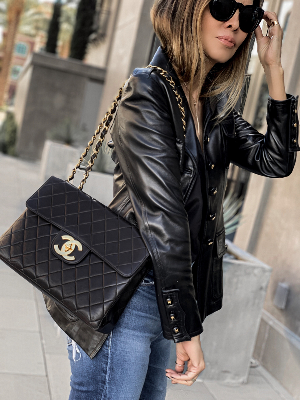 lolario style blogger wearing chanel leather jacket and chanel bag, used designer bags on ebay, ebay authenticate handbags | lolariostyle.com