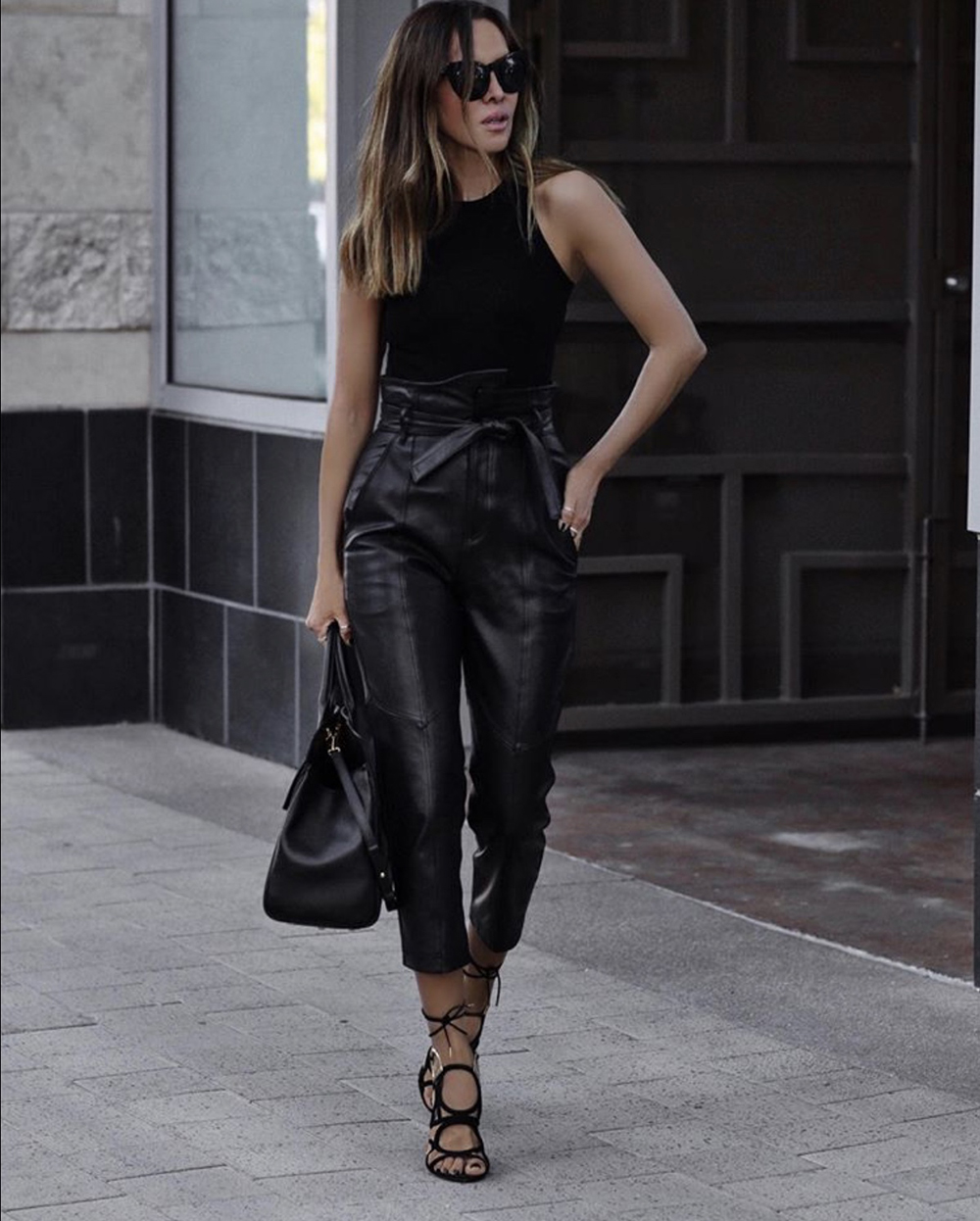 How to Dress Up An All Black Outfit, chic all black outfit, strappy heels, black paper bag pants, leather trousers | lolario style