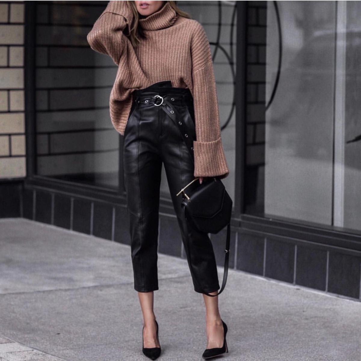fashion blogger lolario style dresses up in stylish thanksgiving outfits featuring paper bag leather pants and chunky knit sweater | lolariostyle.com