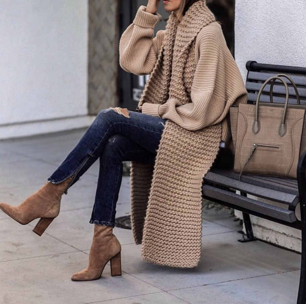 fashion blogger lolario style dresses up stylish thanksgiving outfits featuring a chunky knit sweater distressed jeans and booties | lolariostyle.com