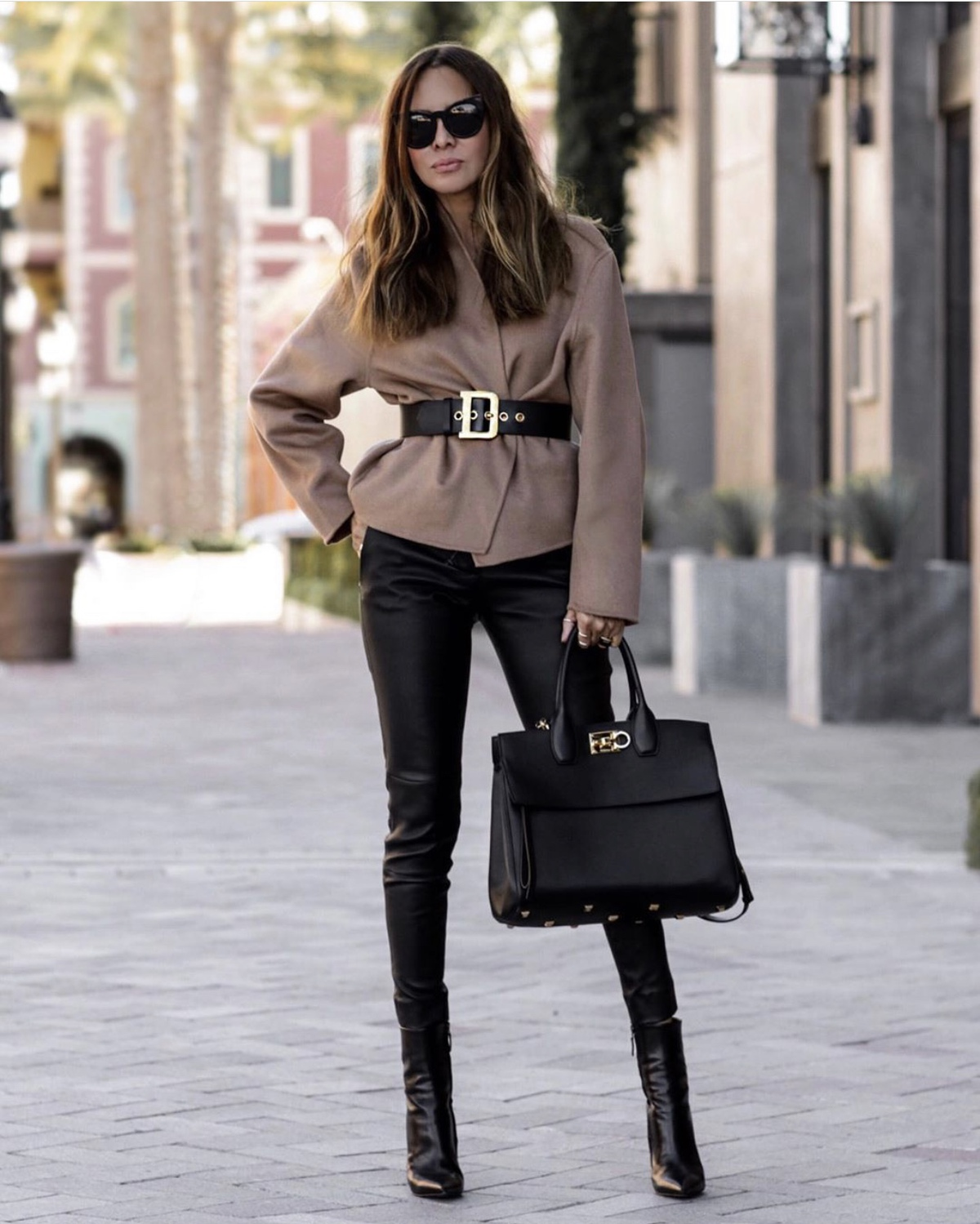 fashion blogger lolario style dresses up in stylish thanksgiving outfits featuring a belted jacket with leather leggings and a salvatore ferragamo tote | lolariostyle.com