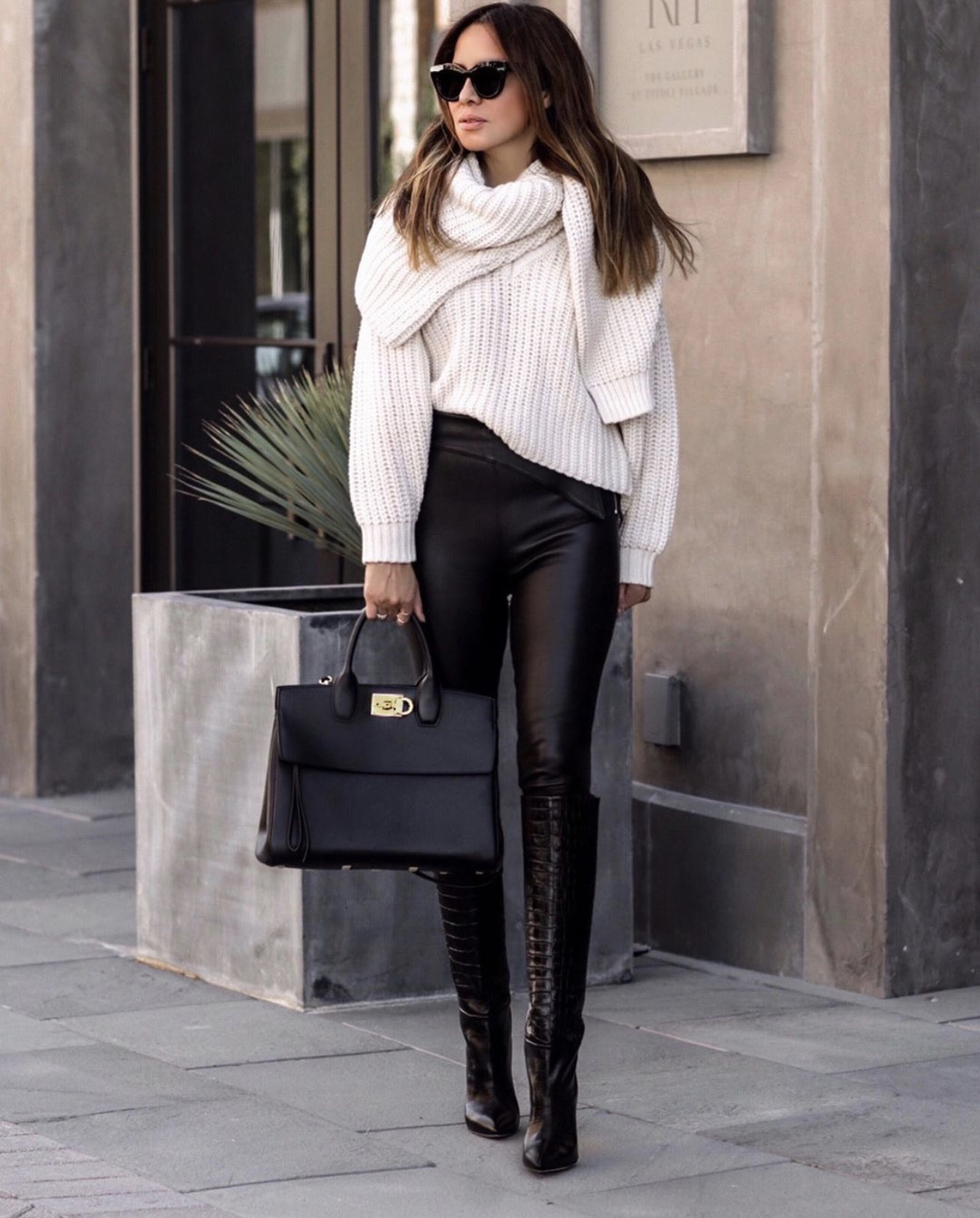fashion blogger lolario style wears a chunky knit sweater with leather pants a salvatore ferragamo tote and croc-effect boots | lolariostyle.com